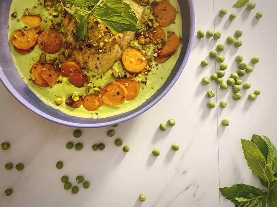 One more overhead shot of my beautiful salmon dinner in a blue bowl on a carrera background with peas and mint