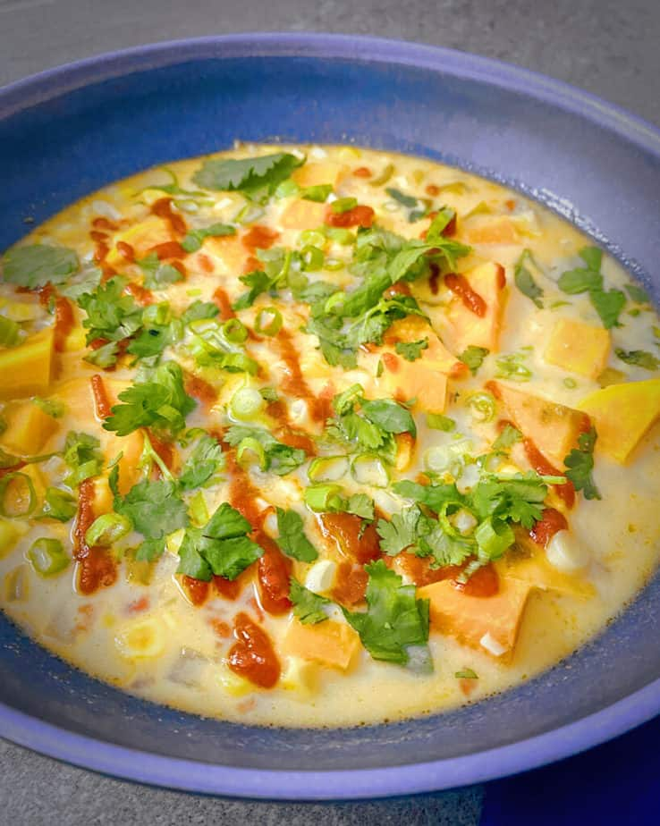 Up close shot of my bright, delicious, Thai Inspired Corn, Sweet Potato Coconut Tom Kha Soup