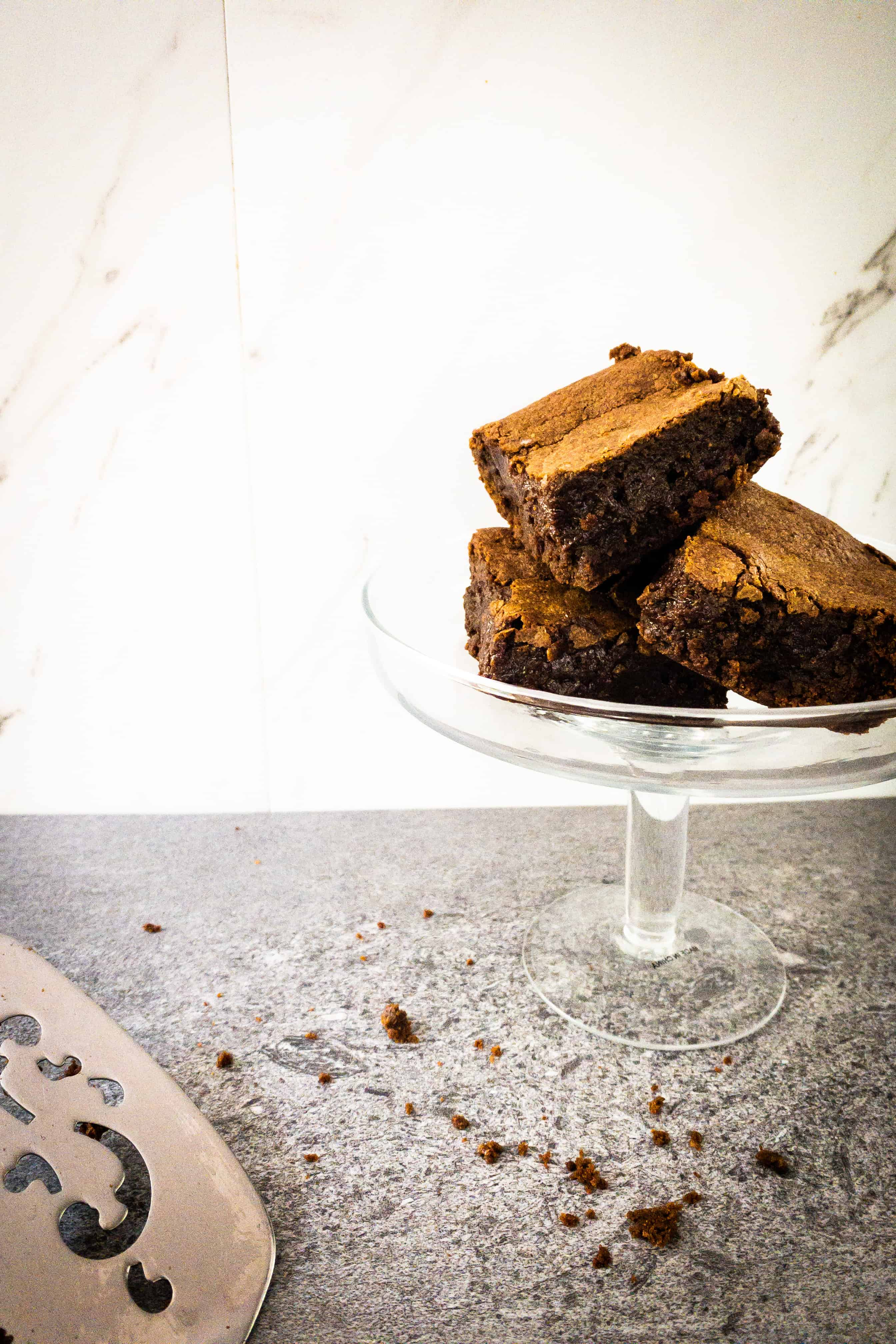 A raised cake plate piled high with Julia Child's brownies