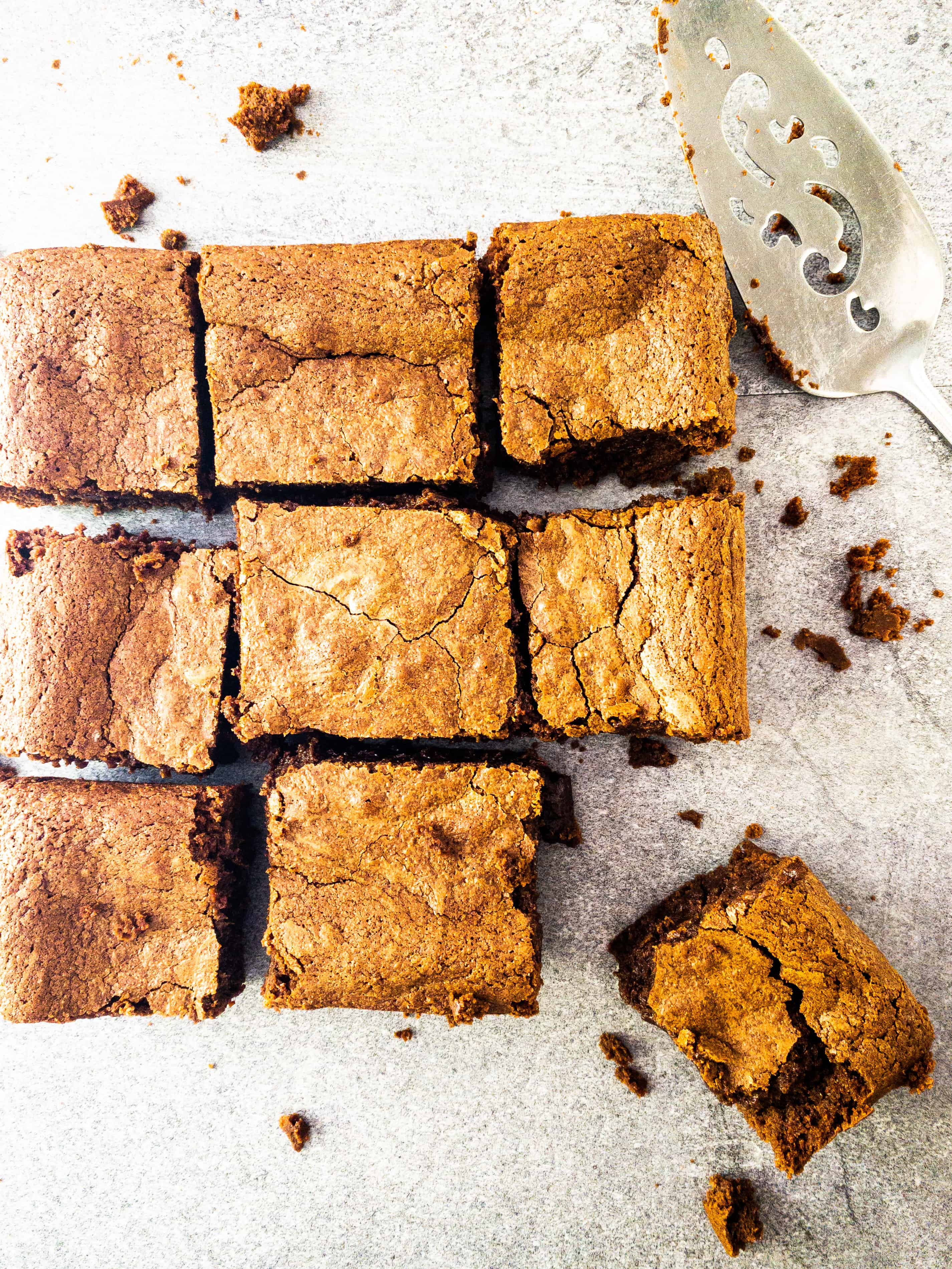 Overhead grid shot of Julia Child's brownies cut into 9 squares.