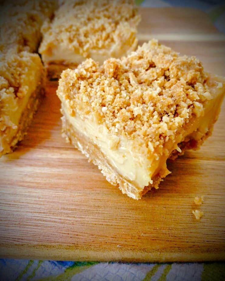 up close shot of key lime dessert bar with coconut ginger crumble topping