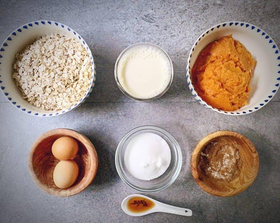rolled oats, almond milk, pumpkin purée, eggs, monkfruit, pumpkin pie spice and vanilla measure out as mis en place