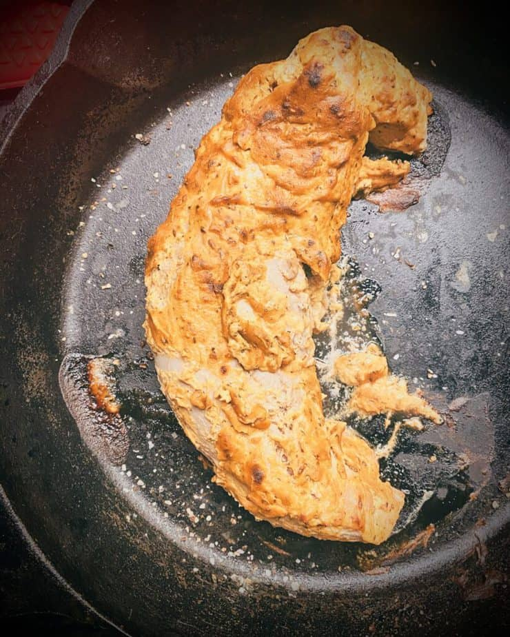 finished mustard glazed pork tenderloin in a cast iron skillet