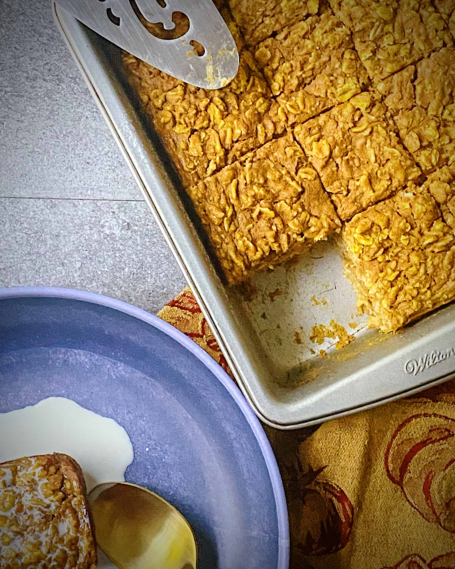 pumpkin baked oatmeal in baking tin with one slice taken out