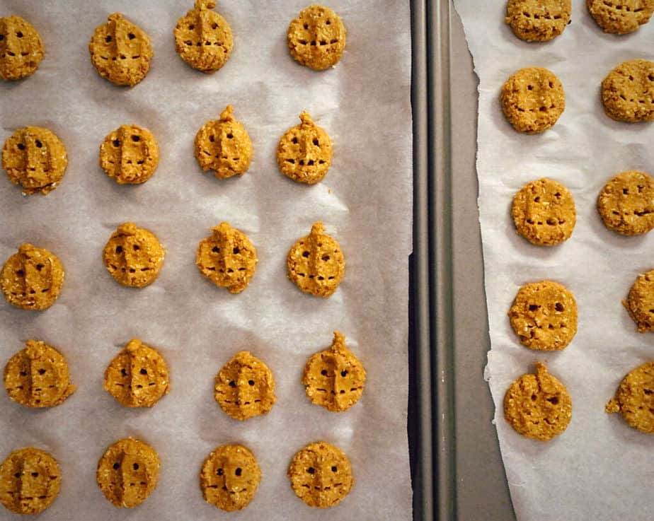 peanut pumpkin dog treats before baking on two parchment lined sheet trays