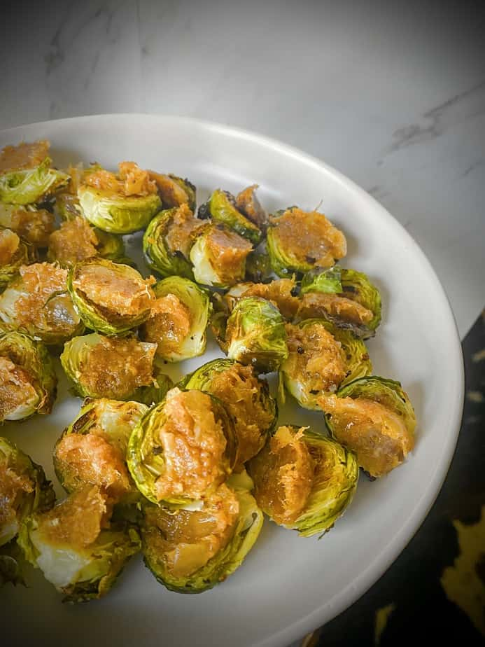 roasted brussels sprouts halves topped with trader joe's bacon jam