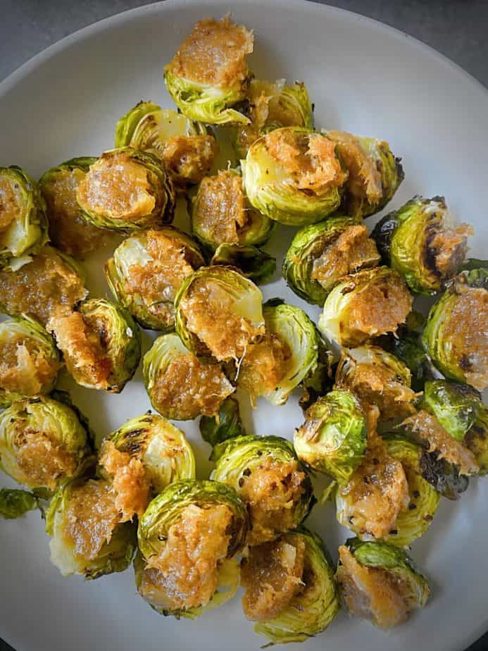 Roasted brussels sprouts with bacon jam on grey pasta plate