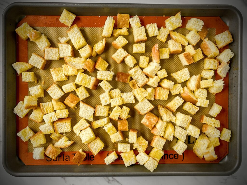 croutons on a silpat lined sheet tray