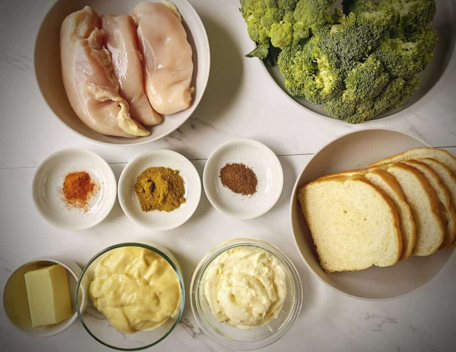 chicken breasts, crowns of broccoli, sliced bread, spices, mayonnaise and cream of chicken soup as mis en place for chicken divan casserole recipe