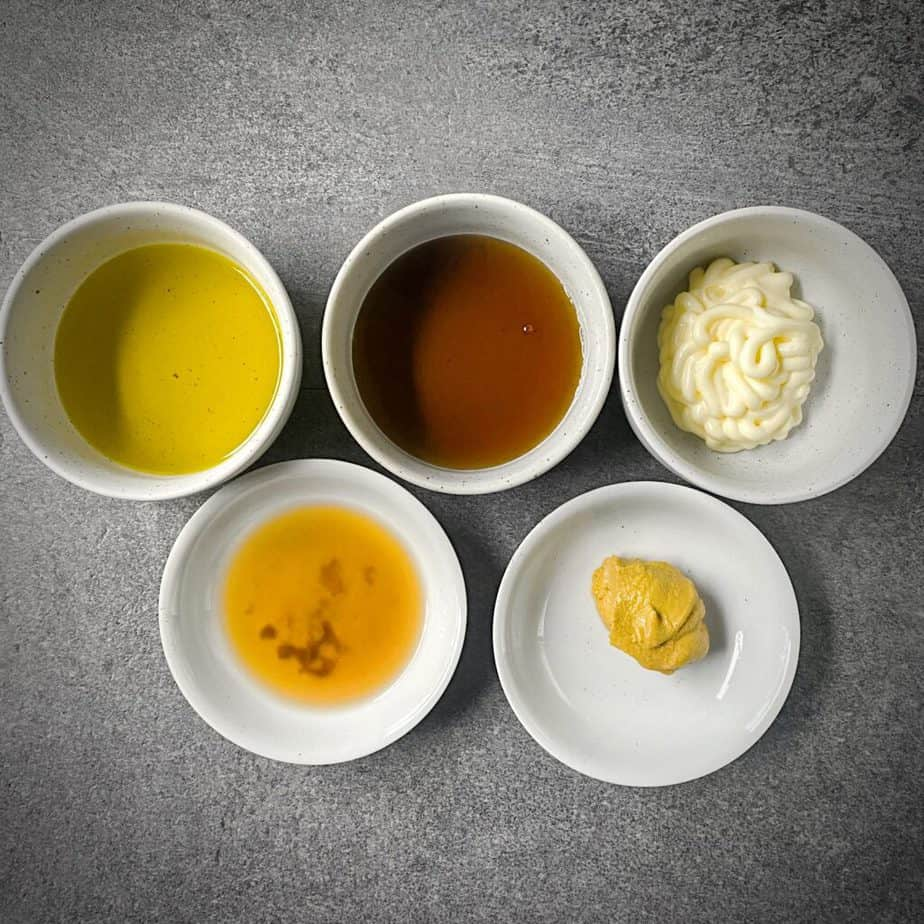 olive oil, maple syrup, mayonnaise, apple cider vinegar and dijon mustard as mis en place for creamy maple vinaigrette