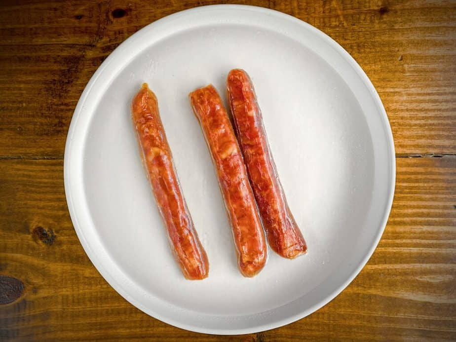 Chinese sausages soaking in hot water