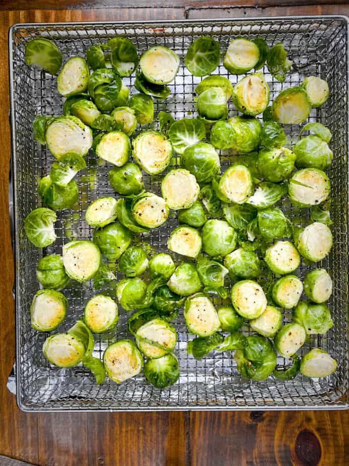 seasoned brussels sprouts in air fryer basket