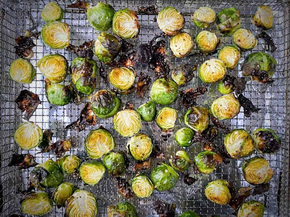 overhead shot of brussels sprouts after cooking in the air fryer while still in the basket