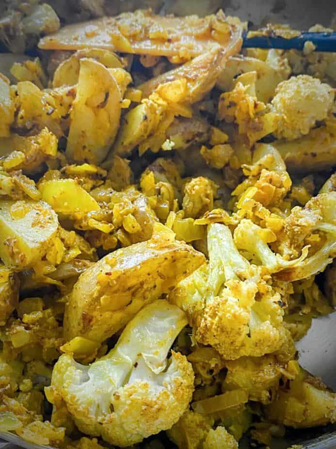 close up shot of aloo gobi in sauté pan