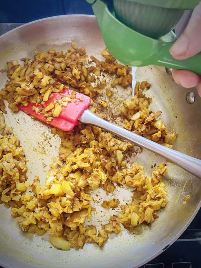 lime juice being squeezed into onion mixture
