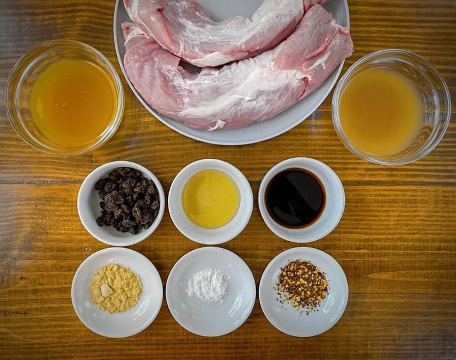 mise en place for roasted pork tenderloin with ginger raisin pan sauce - pork tenderloin, stock, kombucha, raisins, agave, soy sauce, ginger, cornstarch and red pepper flakes