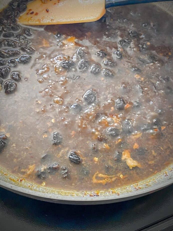 ginger raisin pan sauce cooking in sauté pan before adding cornstarch slurry