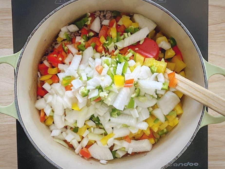 onions and peppers added to browned ground beef