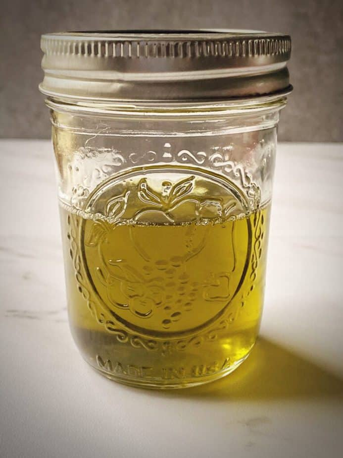 small mason jar filled with completed cbd oil cannabutter