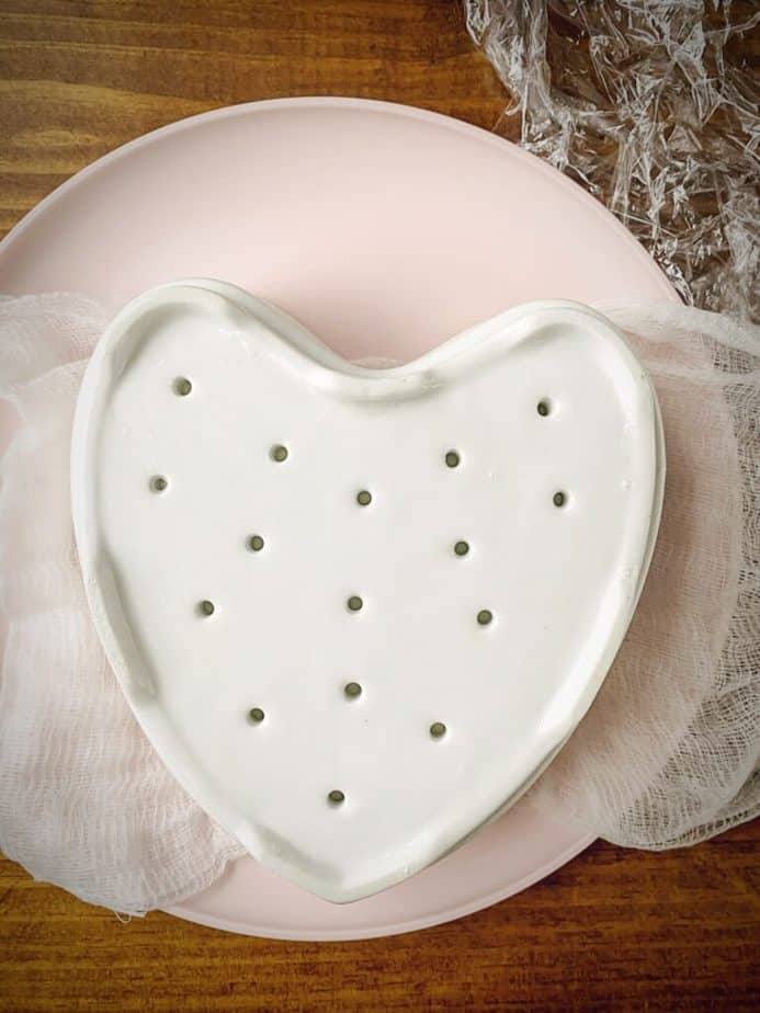 pink plate that has a coeur a la creme inverted onto it