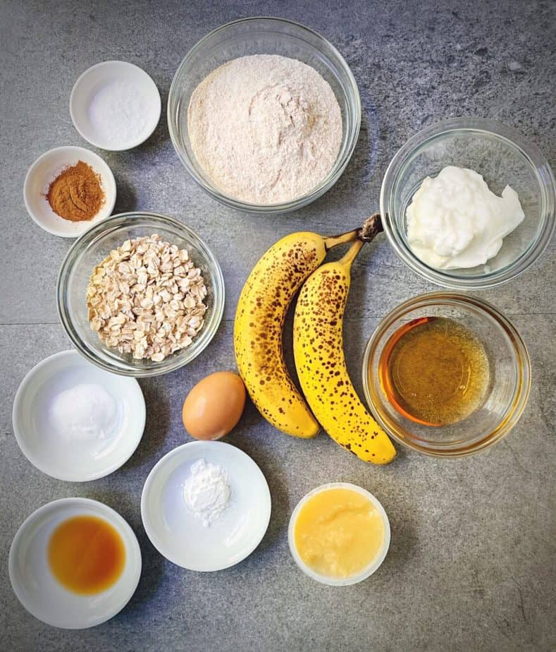 mise en place for healthy whole wheat banana muffin recipe laid out on a grey table