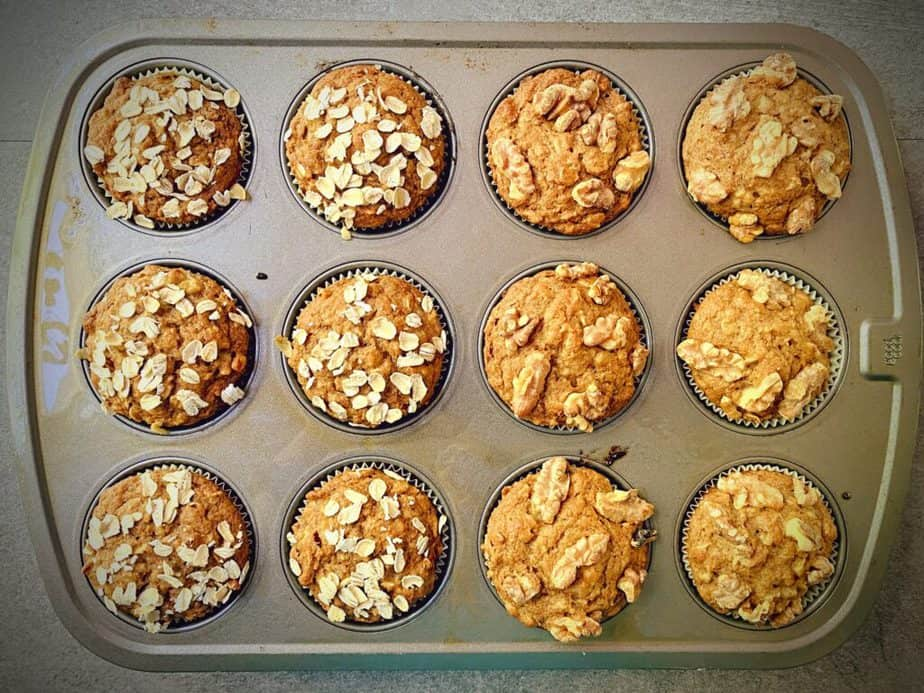 overhead shot of baking tin filled with a dozen healthy whole wheat banana muffins