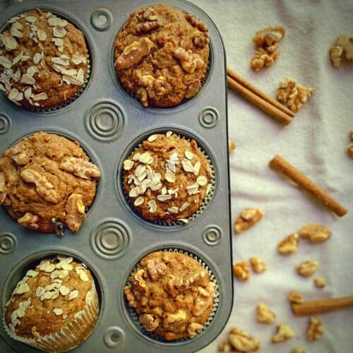 overhead shot of 6 healthy whole wheat banana muffins in a tin