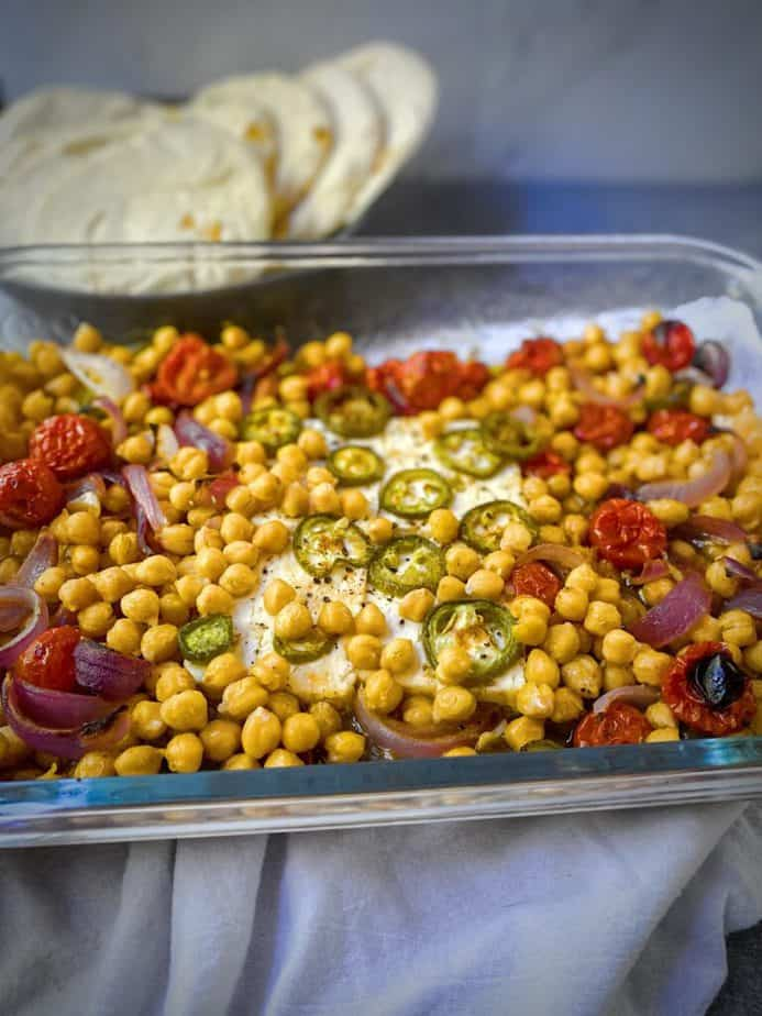 45 degree angle shot of 9x13 with finished mediterranean baked feta with chickpeas and tomatoes