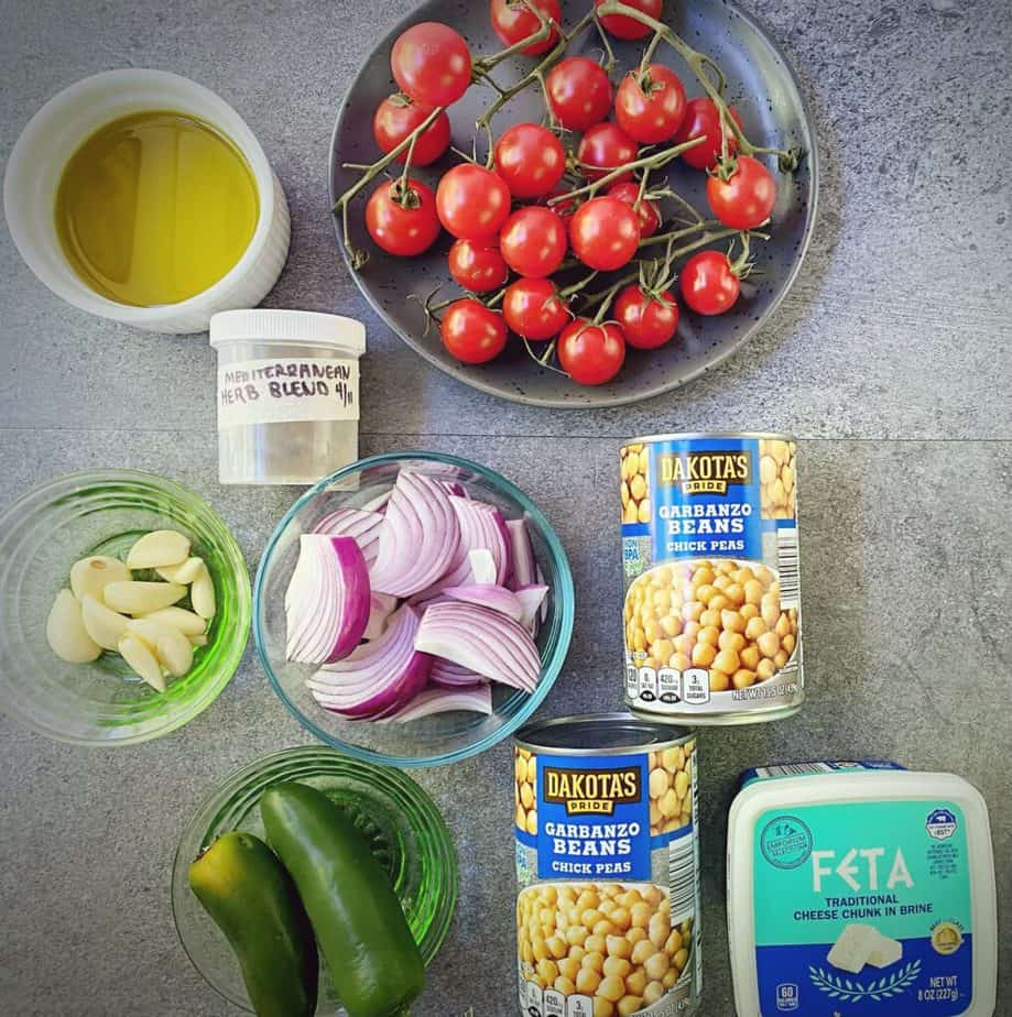 ingredients for making spicy mediterranean baked feta with chickpeas and tomatoes