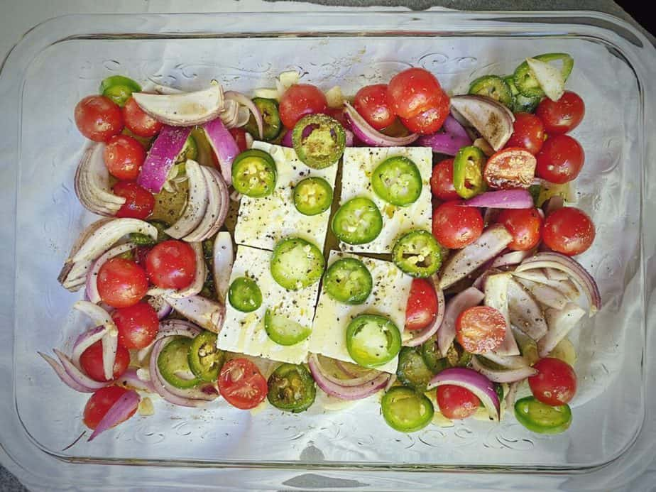 feta added to baking dish and drizzled with oil