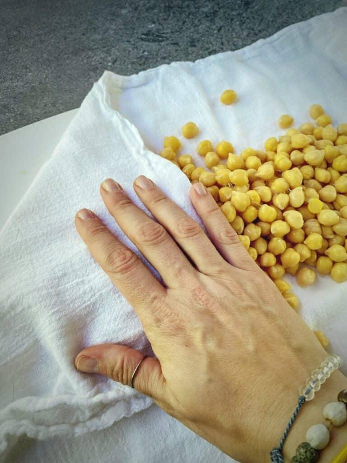 hand blotting excess moisture off chickpeas