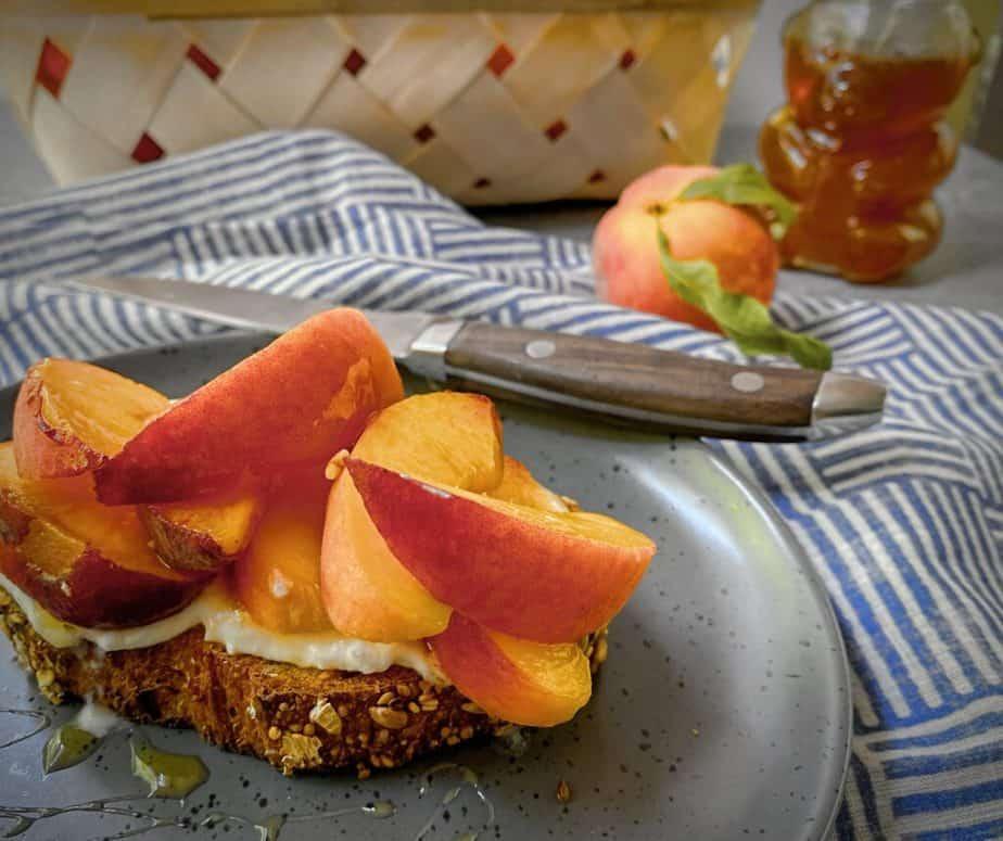 close up angled shot of peach tartine