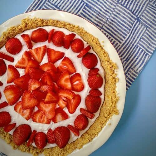 strawberry yogurt pie with press in pretzel crust
