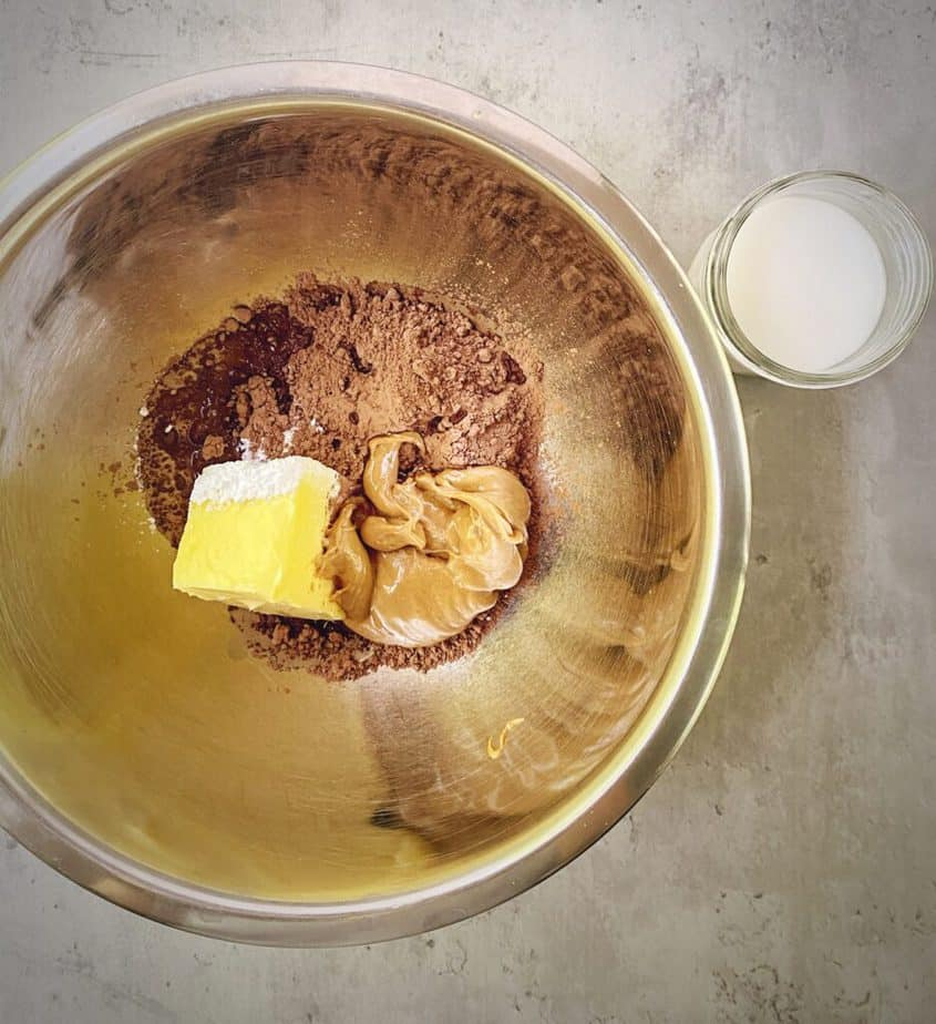 butter, peanut butter, powdered sugar and cacao in a mixing bowl