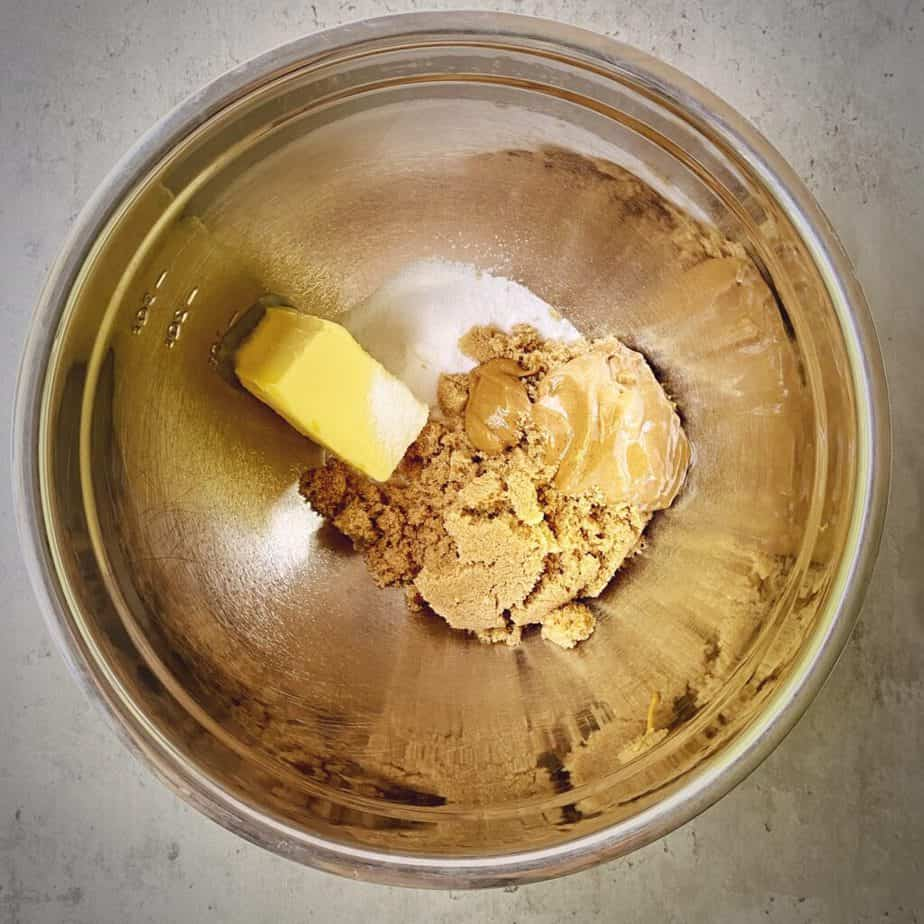 butter, sugar and brown sugar in a mixing bowl