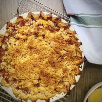 peach crumble pie on a cooling rack
