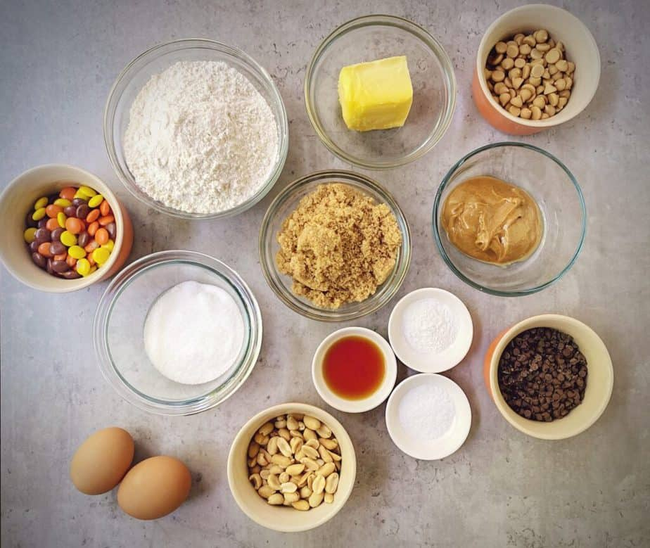 ingredients for making peanut butter chocolate chip cookie cake measured out