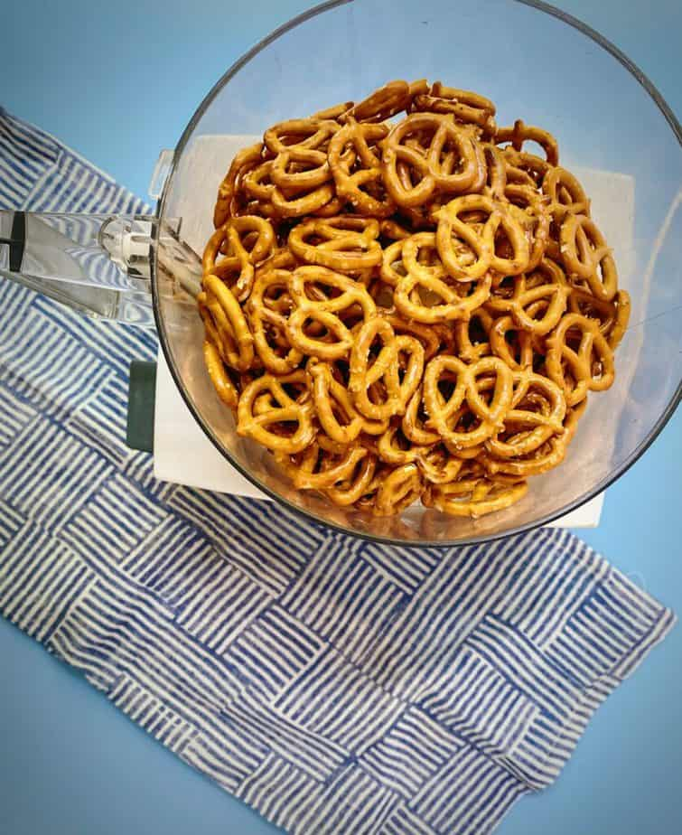 whole pretzels in the bowl of a food processor