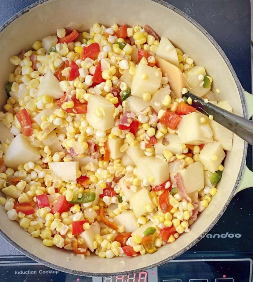 corn and potatoes added to pot
