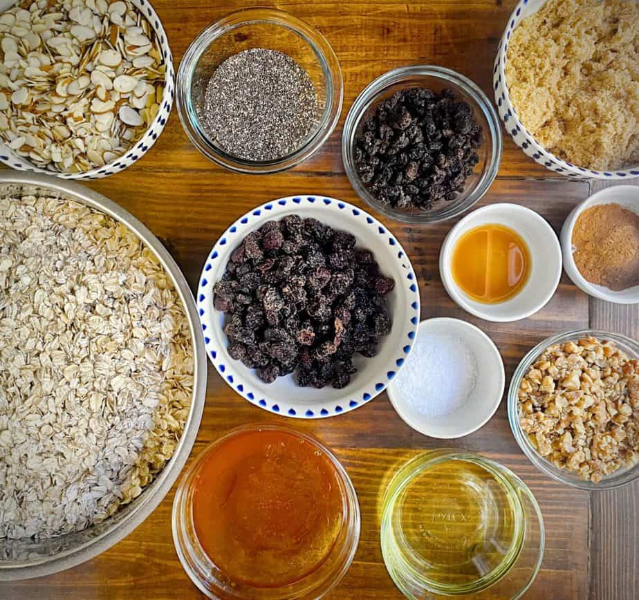 ingredients for making big batch homemade granola measured out into bowls