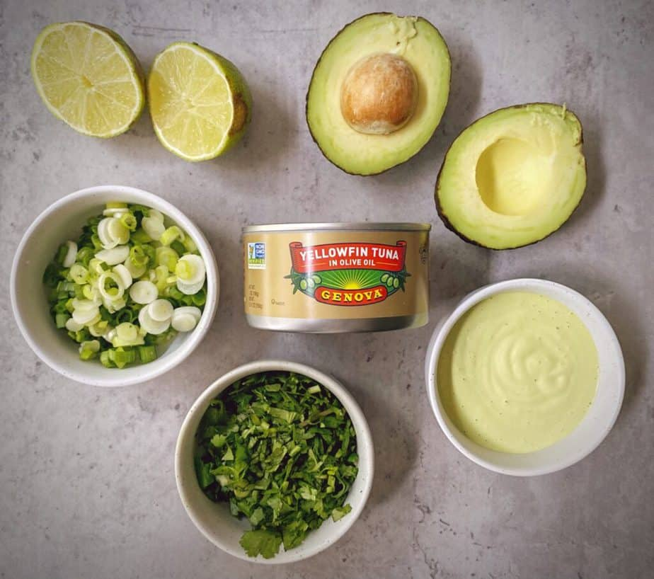 ingredients for making spicy tuna avocado salad measured out into bowls